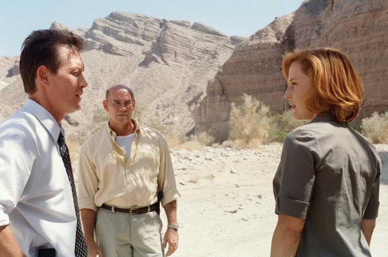 THE X-FILES - SEASON 8:  (L - R) Agent John Doggett (Robert Patrick), Assistant Director Walter Skinner (Mitch Pileggi) and Agent Dana Scully (Gillian Anderson) search for the missing Agent Mulder in part two of the season premiere of THE X-FILES which originally aired Sunday, Nov. 12 (9:00-10:00 PM ET/PT) on FOX.  ©2000FOX BROADCASTING CR:Larry WatsonFOX